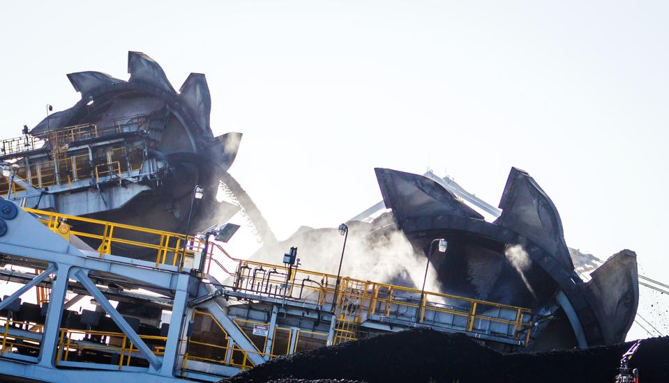 Coal Stockpiles At The Newcastle Coal Terminal As Slump Seen Ending On Deal At Four-Year Low