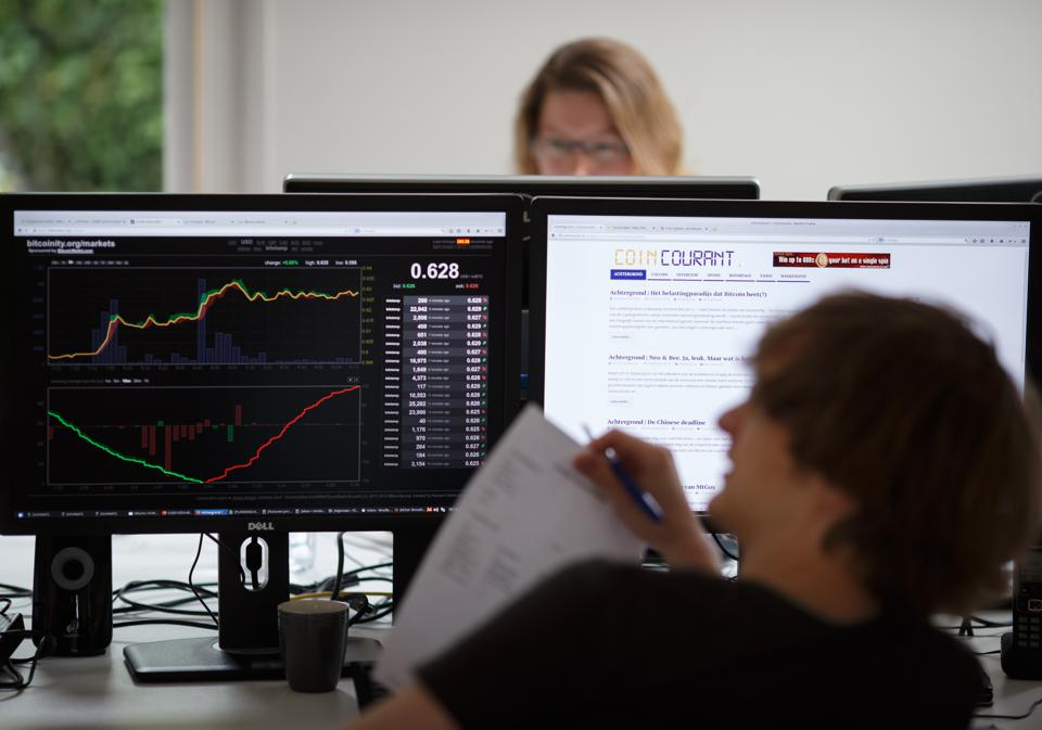Sfox aims to help institutional investors make crypto trades faster, stealthier and at better prices. Above: an employee at Dutch bitcoin broker Bitonic checks crypto prices.