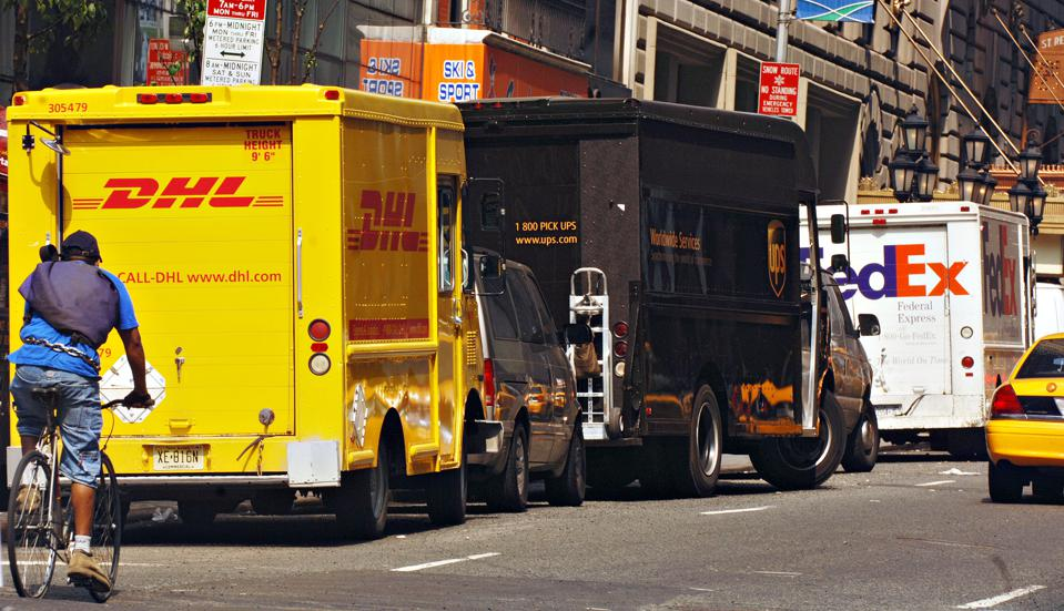 Here's How FedEx's Valuation Compares To UPS