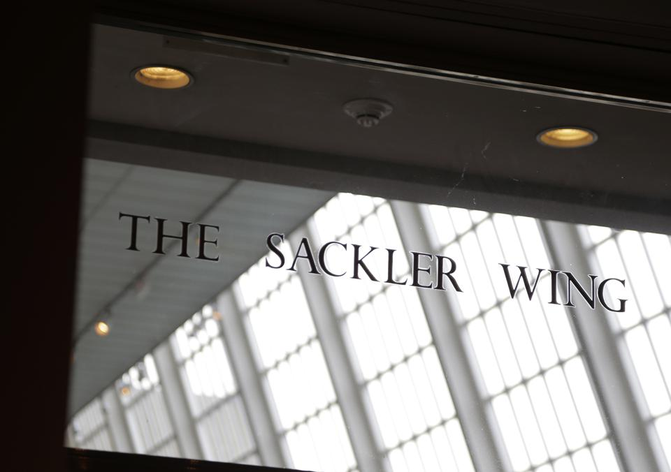 A sign with the Sackler name is displayed at the Metropolitan Museum of Art in New York, Thursday, Jan. 17, 2019. (AP Photo/Seth Wenig)