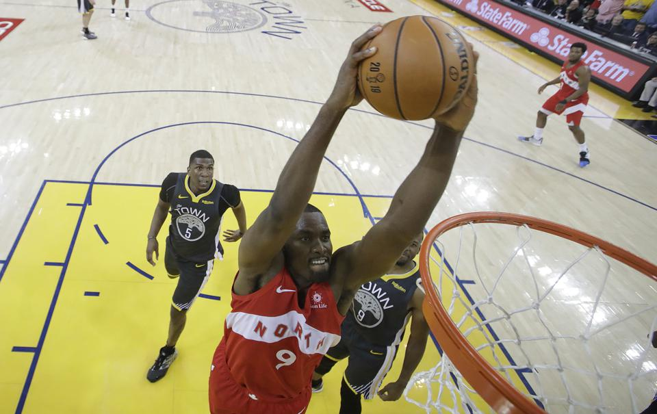 A photo of Toronto Raptors player Serge Ibaka dunking against the Golden State Warriors in Game 4 of the NBA Finals.