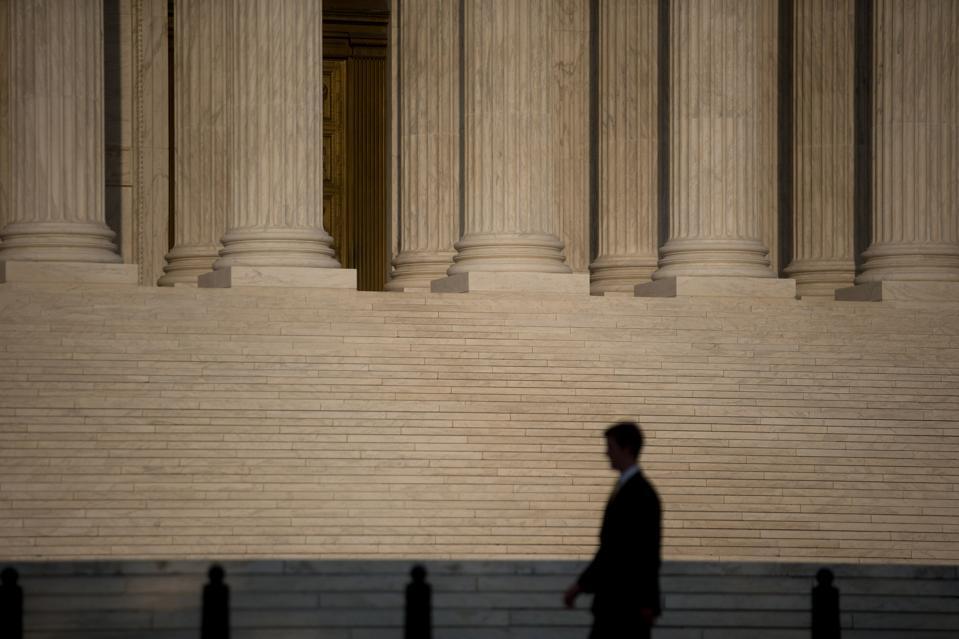 A man walks past the U.S. Supreme Court in Washington, D.C.