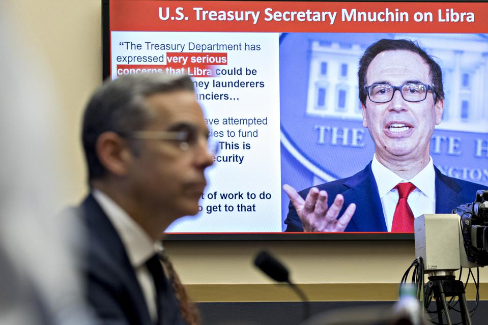 A quote by Steven Mnuchin, U.S. Treasury secretary, is displayed on a monitor