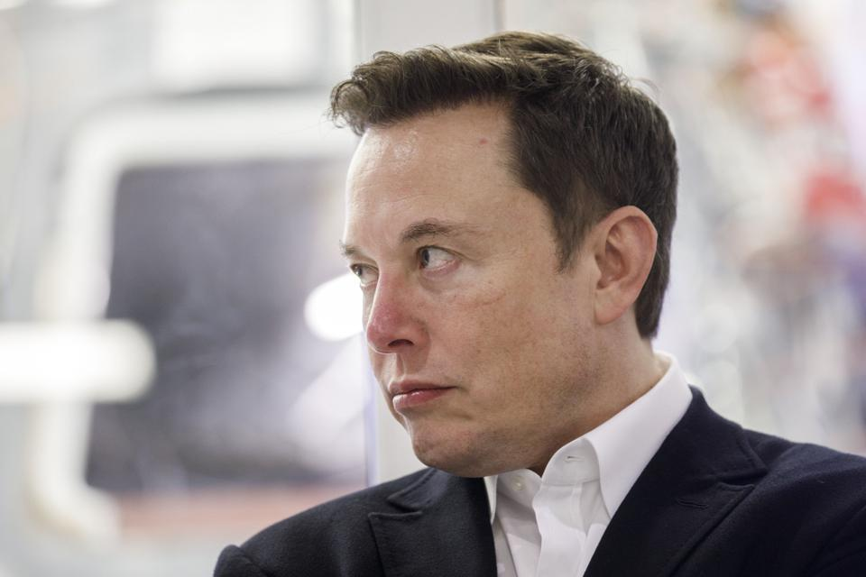 Tesla CEO Elon Musk said the carmaker's share price was too high and said he was selling his possessions.