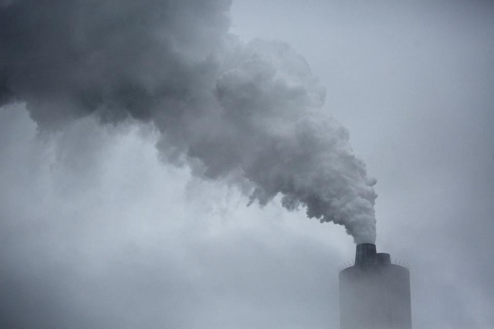 Air Pollution Rises From A Chimney Stack