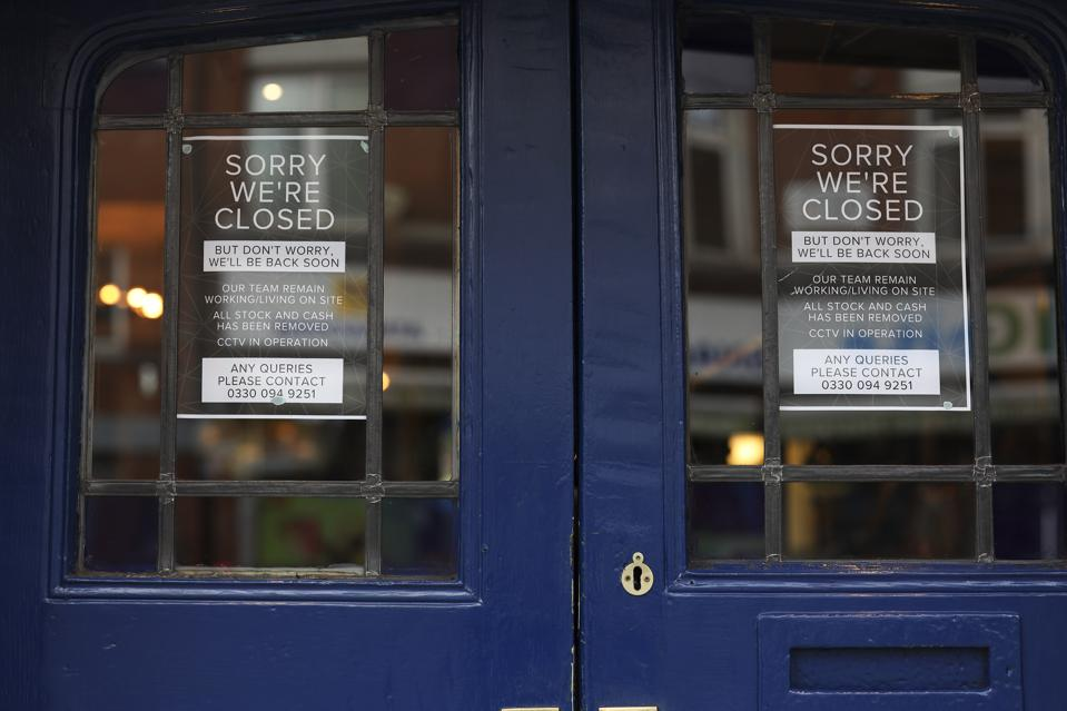 Signs with closure information are displayed at an entrance to a pub in London, U.K., on Friday, March 20, 2020. A shutdown of the U.K. capital would hit the night-time economy hard -- one in three employees in London works between 6 p.m. and 6 a.m., many in the pubs, restaurants and clubs most at risk of survival because of the pandemic. Photographer: Simon Dawson/Bloomberg
