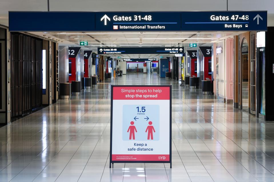 Social distancing sign at airport