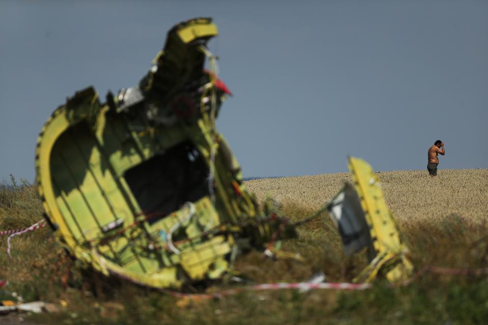 Australian And Dutch Authorities Search Malaysian Flight MH17 Crash Site