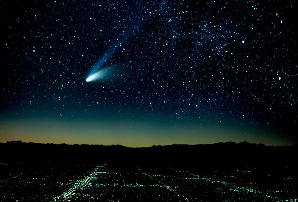 Hale-Bopp Comet And City At Night