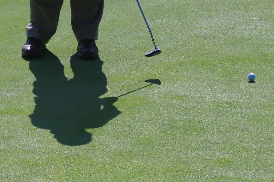 Golfer shadow on the green