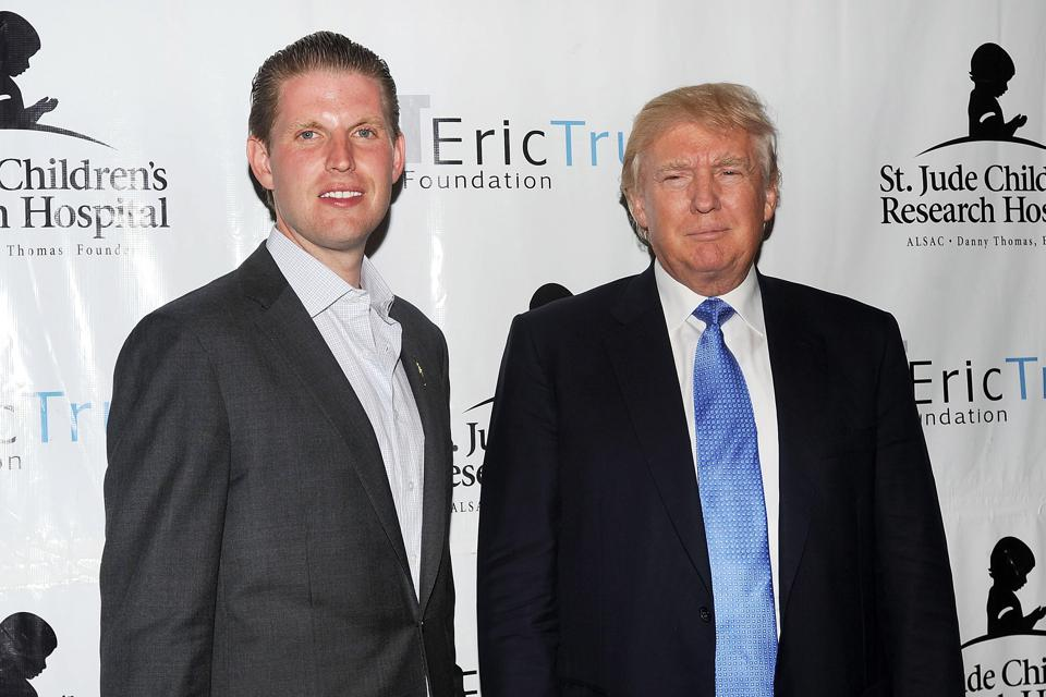 Eric Trump and Donald Trump pose for a photo at the 8th Annual Eric Trump Golf Tournament