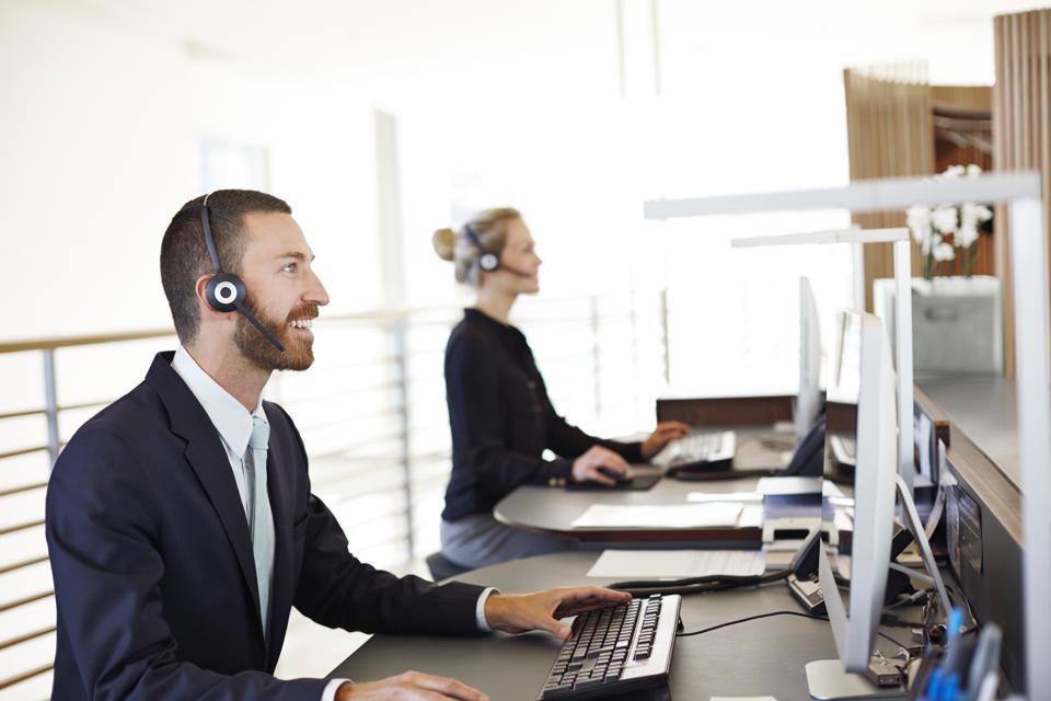 Man & woman with headset doing phone support