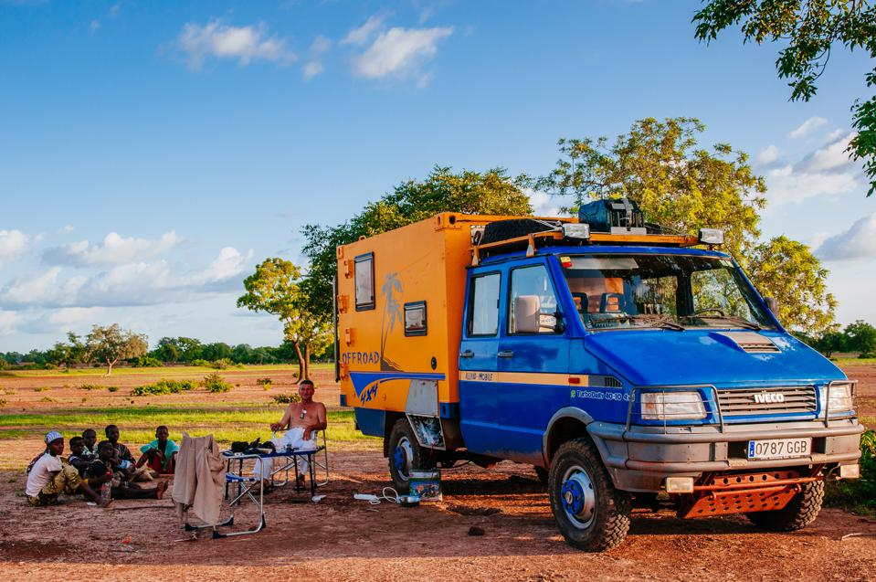 Man with 4x4 expedition truck camping in the bush...