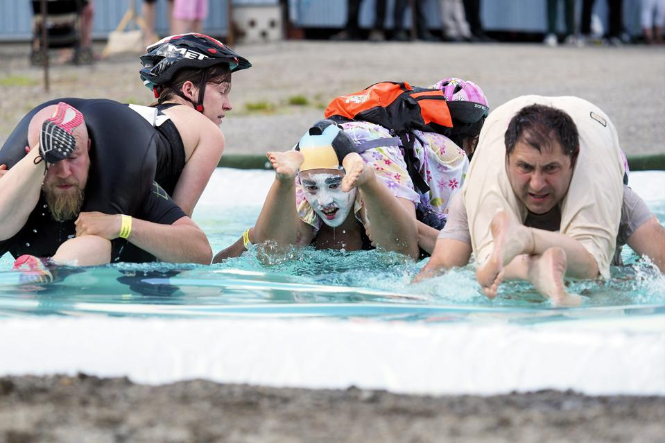Competitors at  the Wife Carrying World Championships in Sonkajarvi, Finland.
