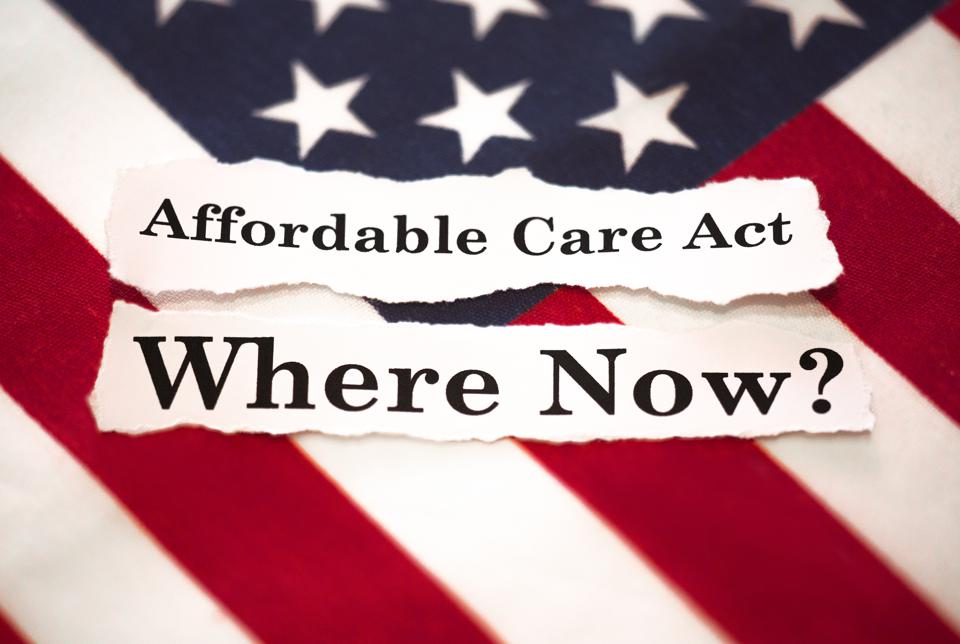 The American flag with words saying affordable care act