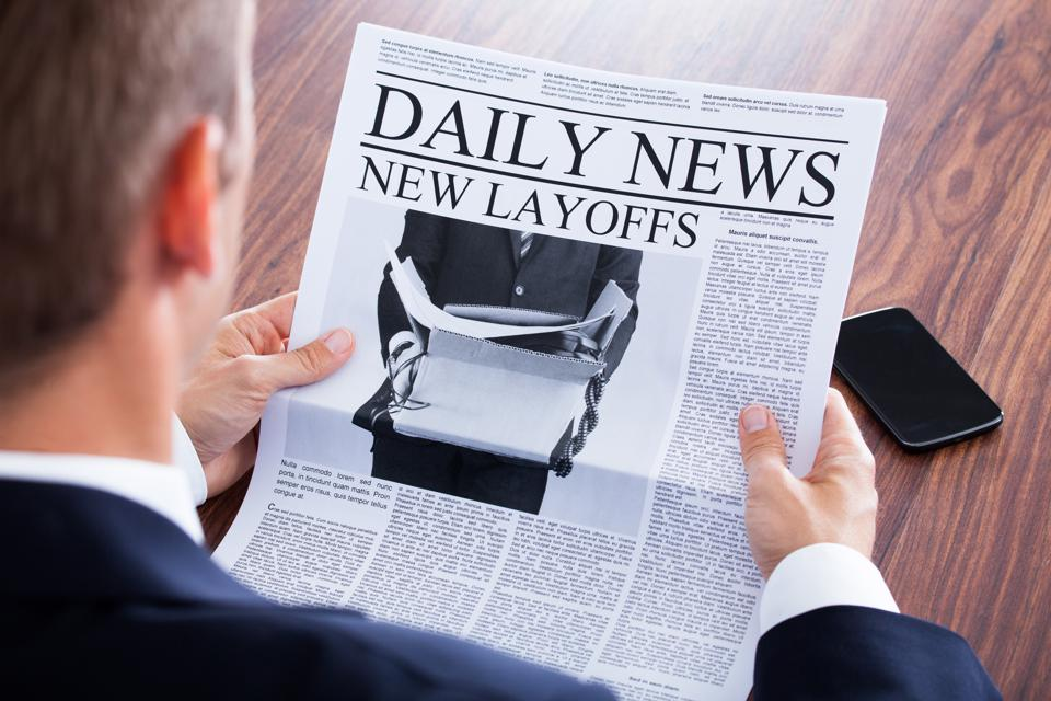 Close-up Of Businessman Reading News