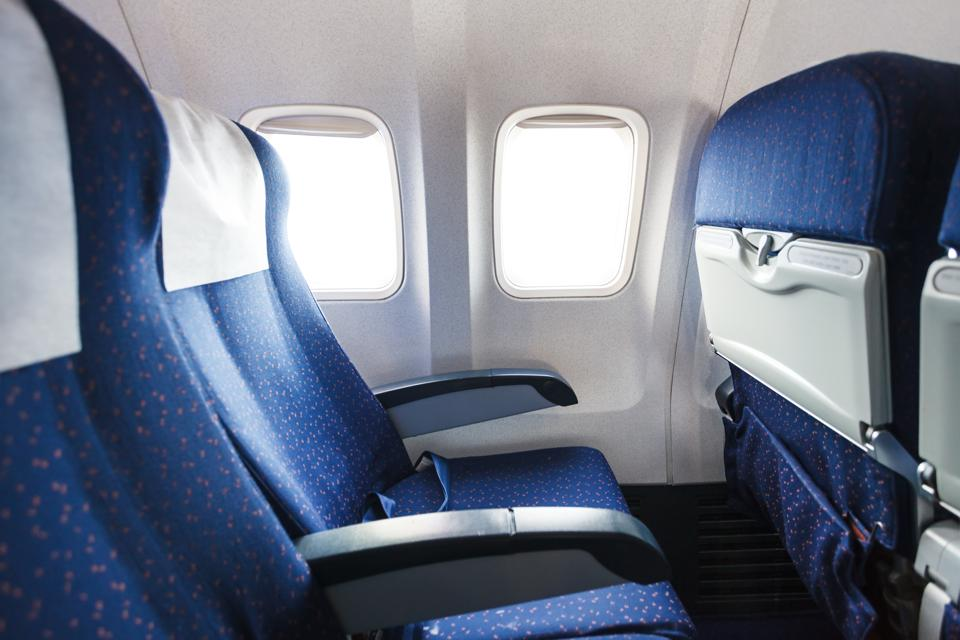 seats in economy class section of airplane