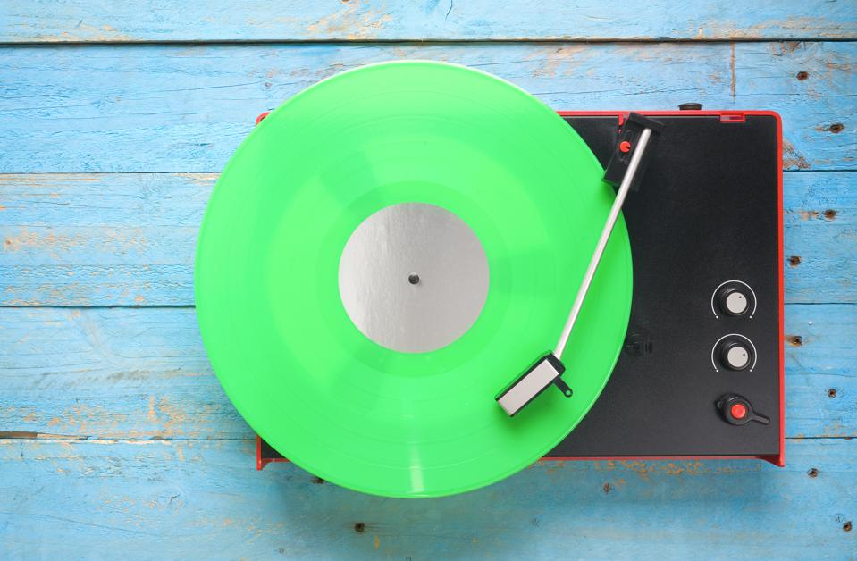 Retro turntable with green vinyl record