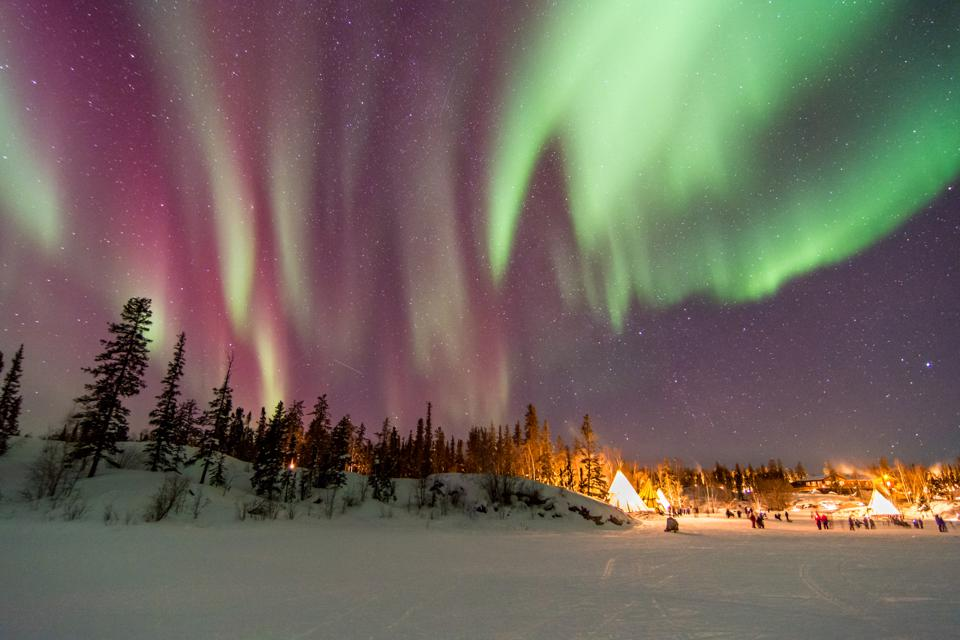Aurora Borealis over tepees in Yellowknife