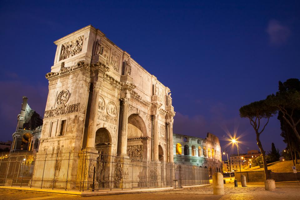 Archaeology Arch Of Constantine at night in Rome, Italy