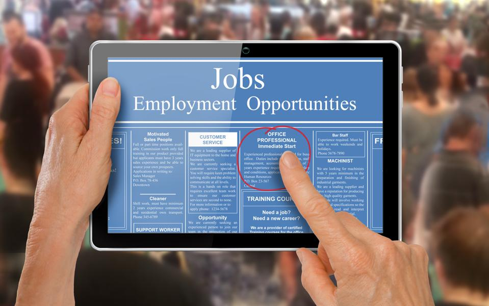 Reading online job ads on a computer tablet -