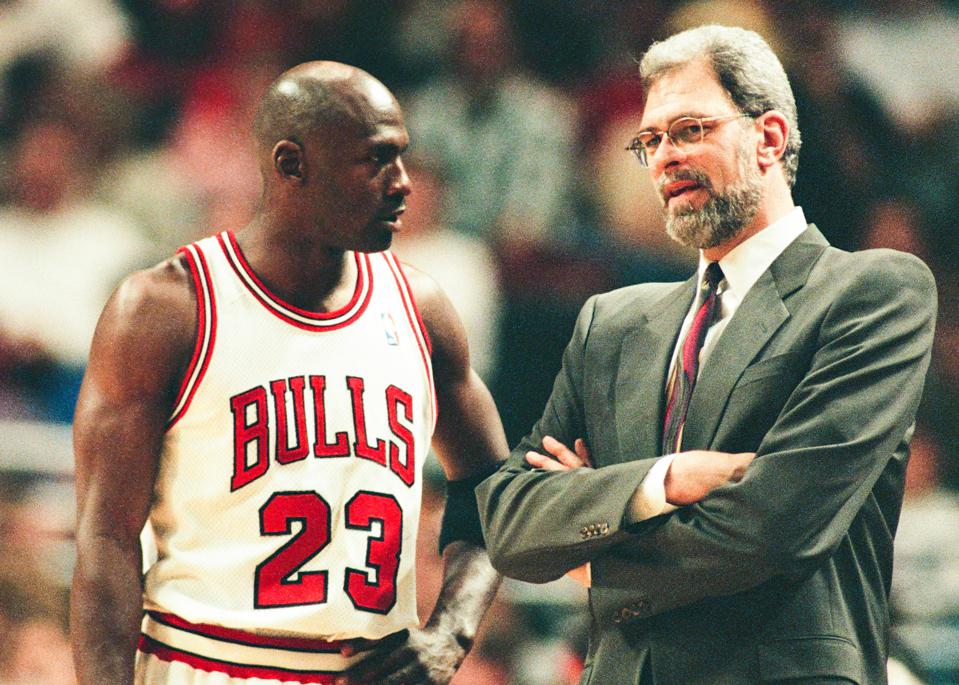 Michael Jordan and Phil Jackson of the Chicago Bulls talk.