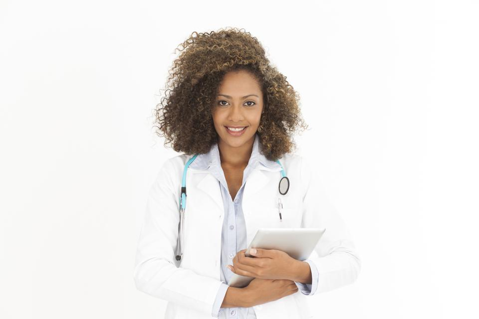 African Female doctor with annotation table