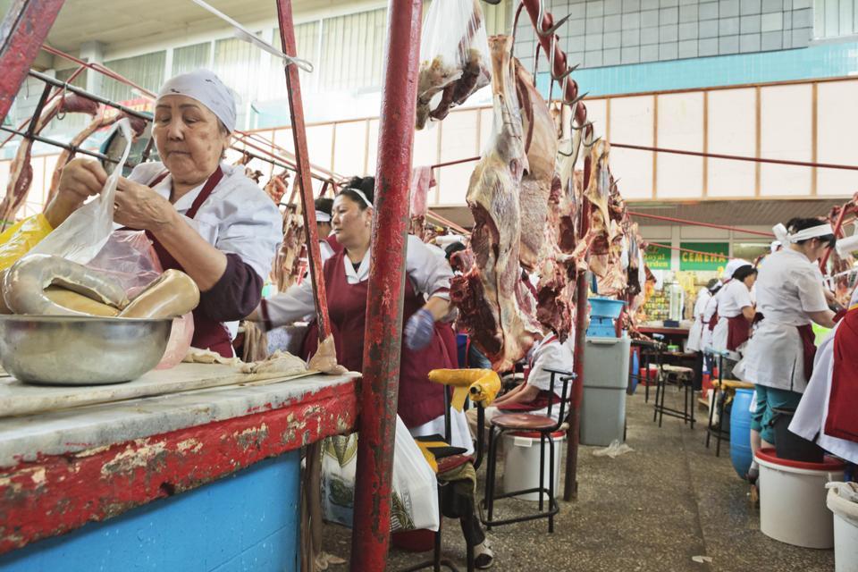 Horse Meat Butchers in Zelyony Bazaar, Almaty, Kazakhstan