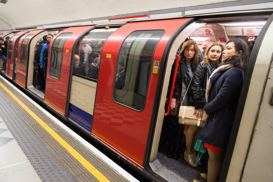 Rush hour commuters on crowded London Underground 'tube' train, England, UK