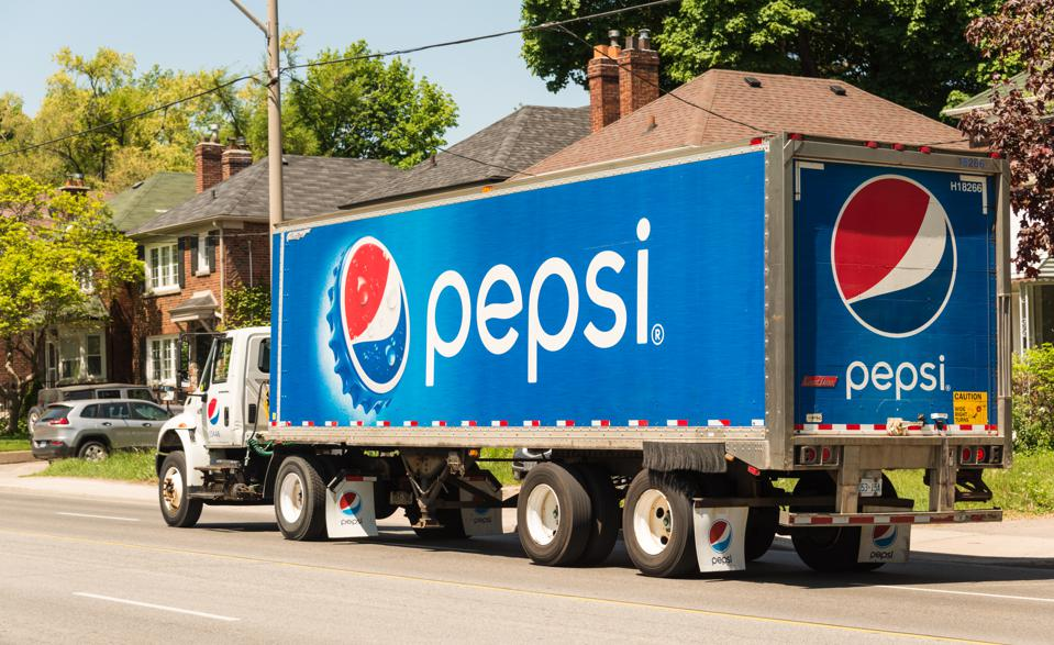 Pepsi Cola Truck rides through the city on a sunny summer...