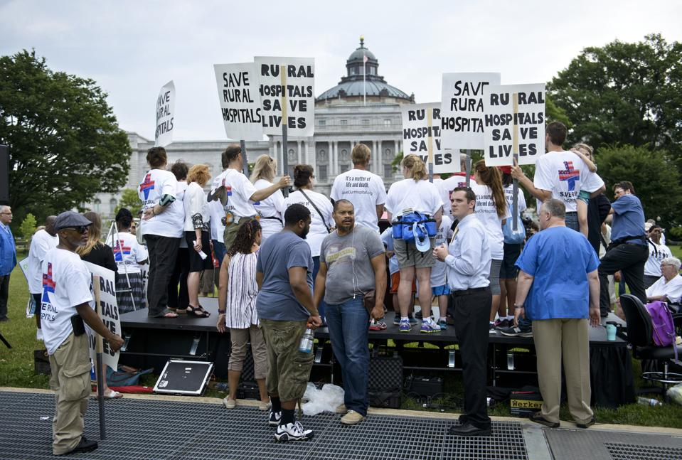 Activists attend a rally for rural hospitals on Capitol Hill.