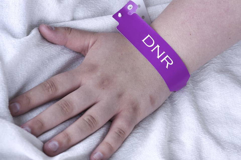 Do Not Resuscitate bracelet on the wrist of a patient in hospital