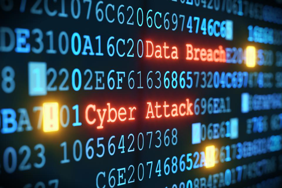 Cyber Attack and Data Breach seen among code on computer screen
