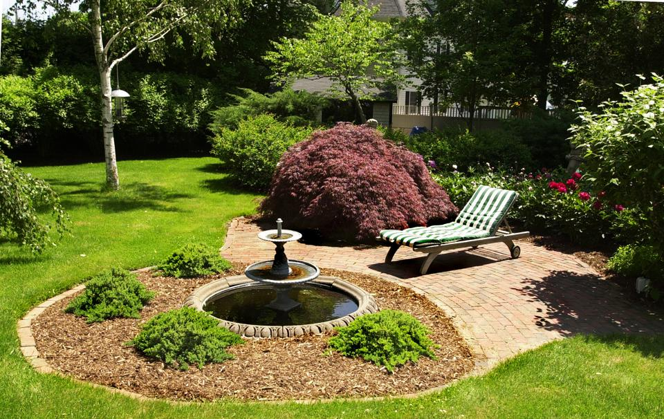 A comfortable chaise lounge provides a resting place to read in the Four Seasons Garden on the estat...