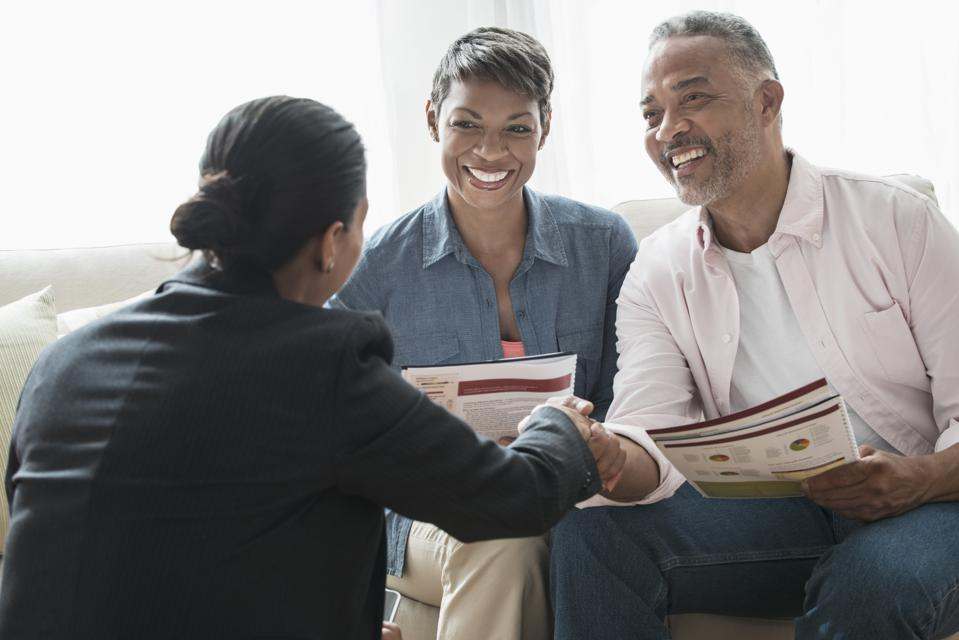 African American couple talking retirement income planning