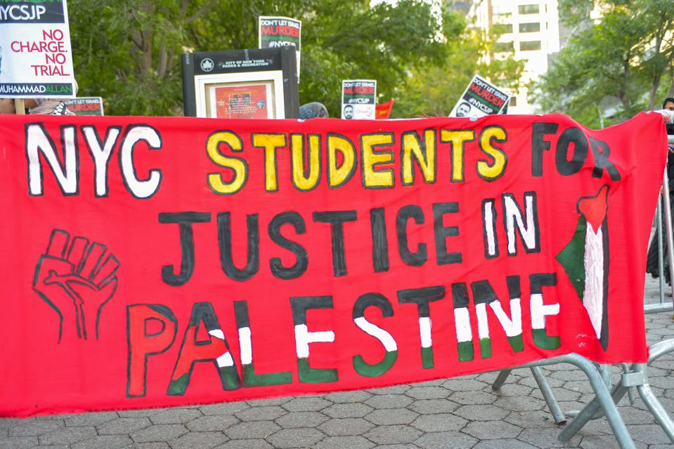 A banner for Students for Justice in Palestine, the...