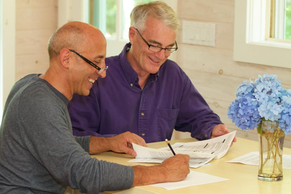 Senior Gay Male Couple Working Together on Financial Documents