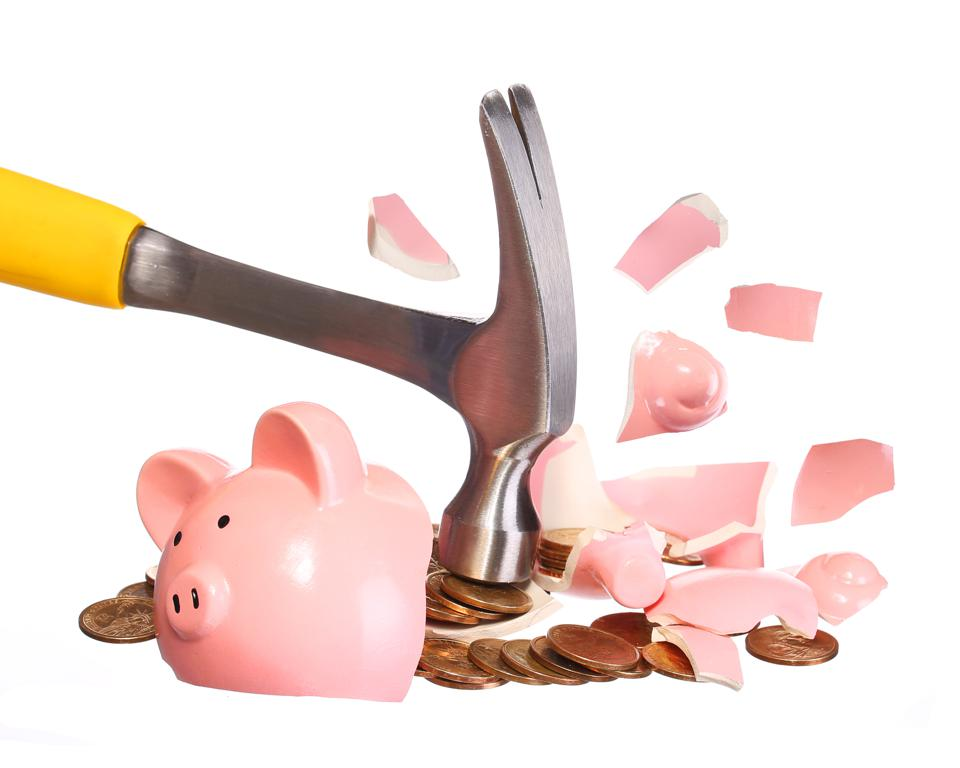 Money Concept. Hammer breaking Piggy Bank with Gold Coins isolated