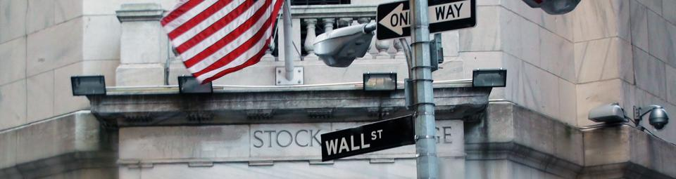Wall Street Sign With US Flag In New York City