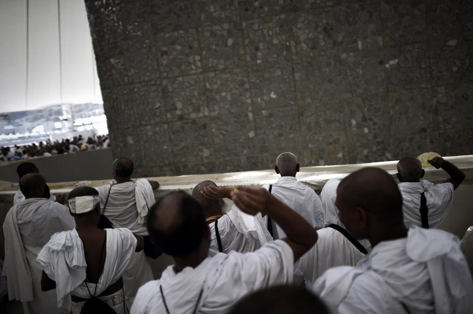 Muslim pilgrims throw pebbles at pillars during the 'Jamarat' ritual, the stoning of Satan, in Mina near the holy city of Mecca.  (MOHAMMED AL-SHAIKH/AFP/Getty Images)