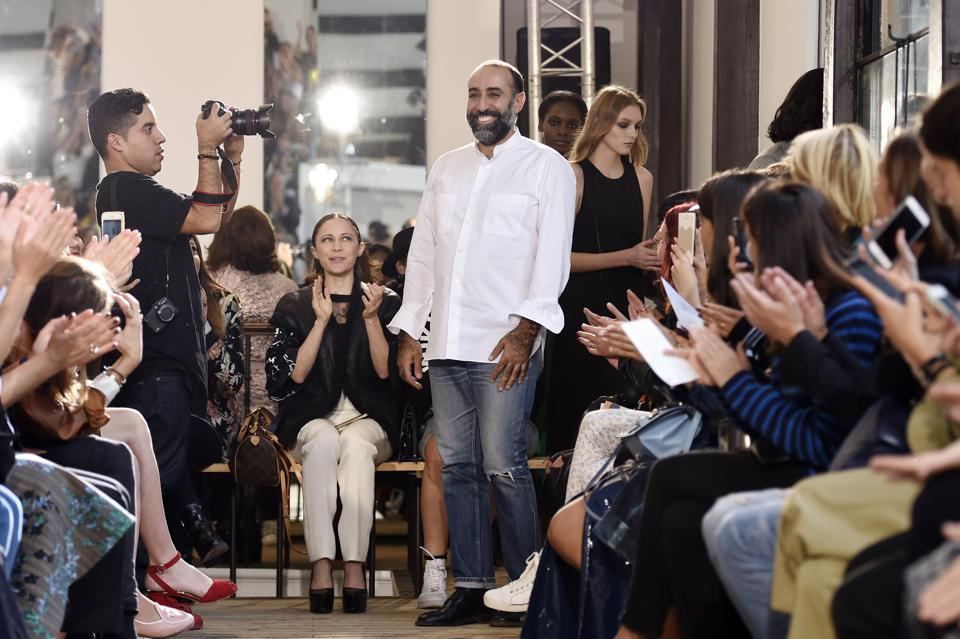 Lebanese designer Rabih Kayrouz acknowledges the public after his show in Paris. (Photo: MIGUEL MEDINA/AFP/Getty Images)