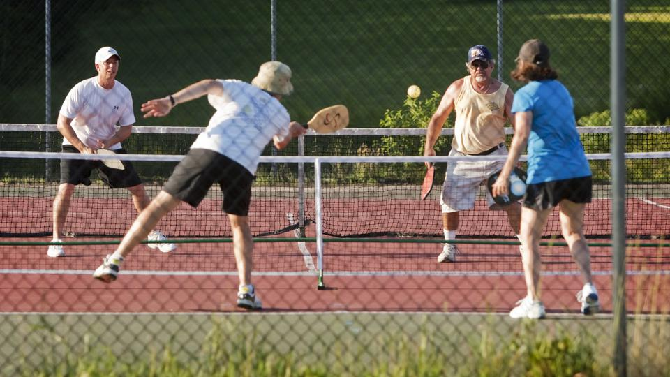Teams of doubles compete during a ″Pickleball″ match at Sunset Ridge Golf Course in Westbrook on Fri