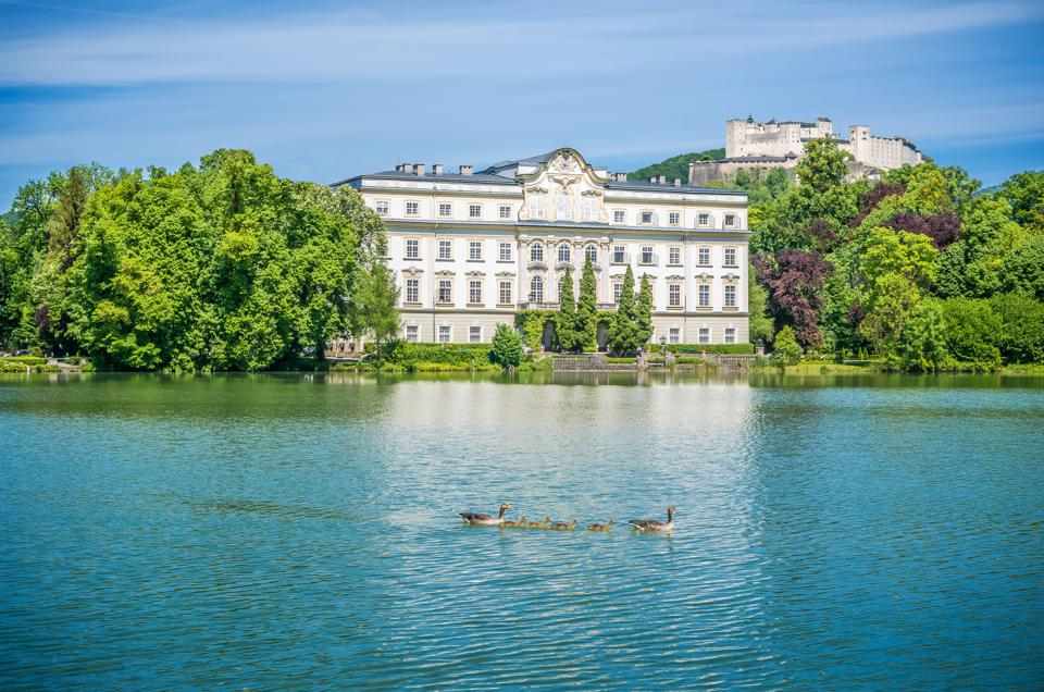 Famous Schloss Leopoldskron with Hohensalzburg Fortress in Salzburg, Austria