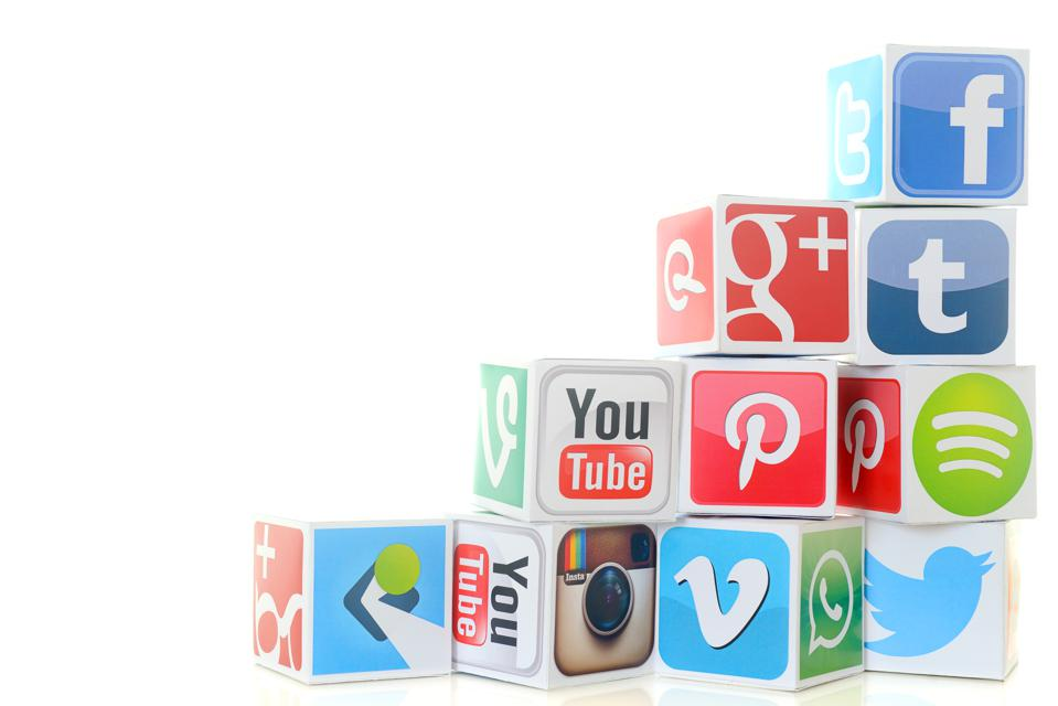 Social media icon cubes including Twitter and Facebook