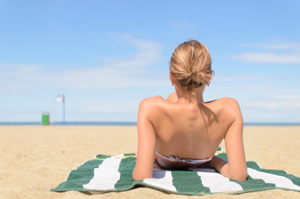 Girl on the beach sunbathing