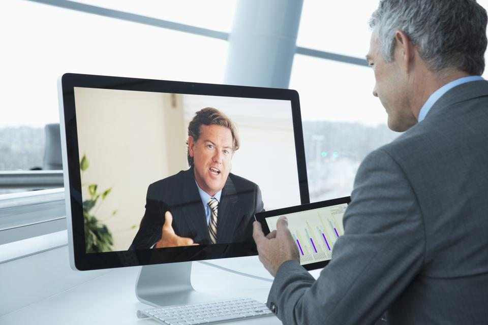 Caucasian businessmen teleconferencing in office