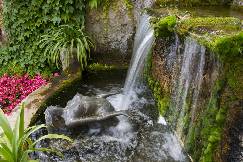 Waterfall with statue of nude woman at the Hotel Palazzo...