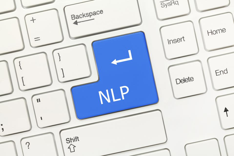 White conceptual keyboard - NLP (blue key)