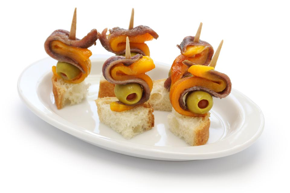 Pintxos with anchovies, olives and paprika