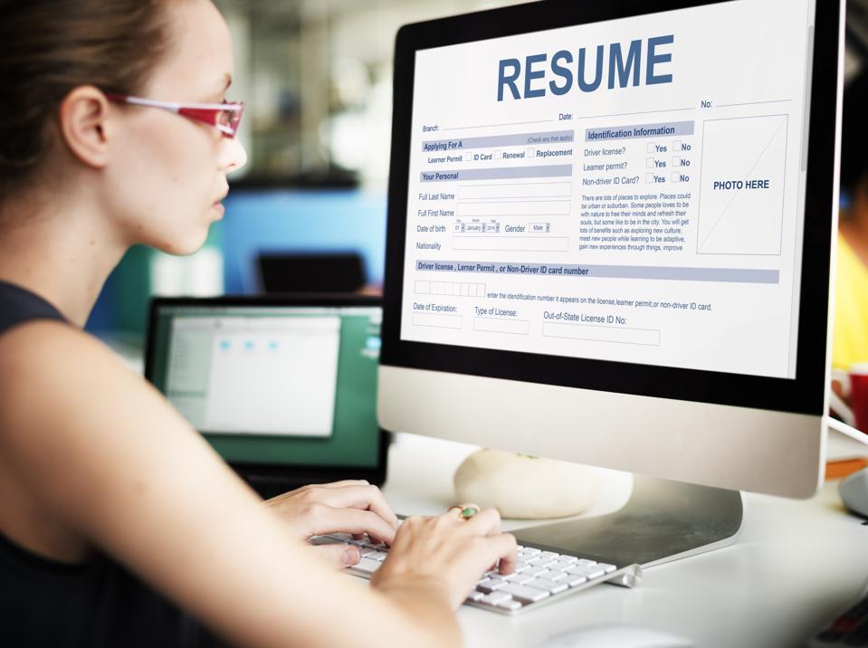 Image result for woman check cv on computer desktop